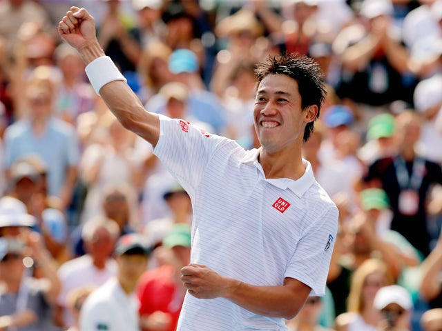Kei Nishikori of Japan celebrates after defeating Novak Djokovic of Serbia in their men's singles semifinal match on Day Thirteen of the 2014 US Open at the USTA Billie Jean King National Tennis Center on September 6, 2014