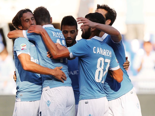 Stefano Mauri with his teammates of SS Lazio celebrates after scoring the third team's goal during the Serie A match between SS Lazio and AC Cesena at Stadio Olimpico on September 14, 2014