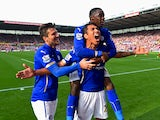 Leonardo Ulloa of Leicester City celebrates scoring the first goal with David Nugent and Jeffrey Schlupp of Leicester City during the Barclays Premier League match between Stoke City and Leicester City at Britannia Stadium on September 13, 2014