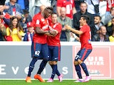 Lille's Belgian forward Divock Origi is congratulated by teammates after scoring a goal during the French L1 football match Lille (LOSC) vs Nantes (FCN) on September 14, 2014