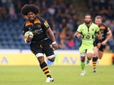Ashley Johnson of Wasps breaks away to score the first try during the Aviva Premiership match between Wasps and Northampton Saints at Adams Park on September 14, 2014