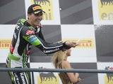 Loris Baz of France and Kawasaki Racing Team celebrates the third place on the podium at the end of the race 1 during the FIM Superbike World Championship - Race at Portimao Circuit on July 6, 2014