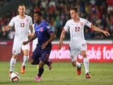Czech Republic's Lukas Vacha (L) and Vladimir Darida (R) and Netherland's midfielder Georginio Wijnaldum vie for the ball during the UEFA Euro 2016 Group A match on September 9, 2014