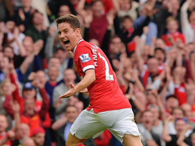 Manchester United's Spanish midfielder Ander Herrera celebrates scoring their second goal during the English Premier League football match between Manchester United and Queens Park Rangers at Old Trafford in Manchester, north west England on September 14,