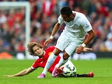 Mauricio Isla of QPR is challenged by Daley Blind of Manchester United during the Barclays Premier League match between Manchester United and Queens Park Rangers at Old Trafford on September 14, 2014