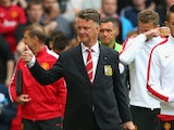 Manchester United Manager Louis van Gaal gives a thumbs up prior to the Barclays Premier League match between Manchester United and Queens Park Rangers at Old Trafford on September 14, 2014