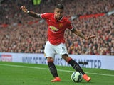Manchester United's Argentinian defender Marcos Rojo crosses the ball during the English Premier League football match between Manchester United and Queens Park Rangers at Old Trafford in Manchester, north west England on September 14, 2014