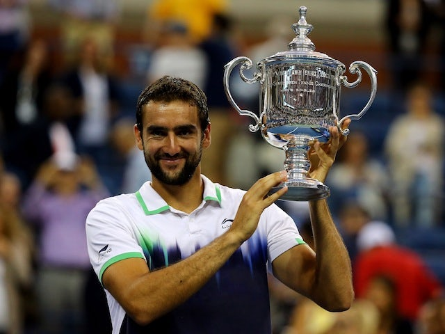 Marin Cilic of Croatia poses with the trophy after winning the US Open at Flushing Meadows, New York on September 8, 2014