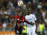 Metz' Malian forward Modibo Maiga (R) vies with Nice's French midfielder Nampalys Mendy during the French L1 football match Nice (OGC Nice) vs Metz (FC Metz) on September 13, 2014