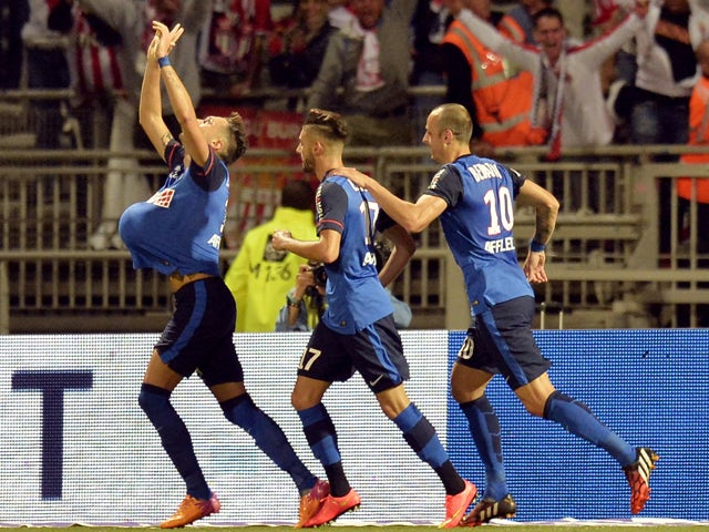 Monaco's Argentine midfielder Lucas Ocampos celebrates with teammates after scoring a goal during the French L1 football match between Lyon and Monaco at the Gerland stadium in Lyon on September 12, 2014
