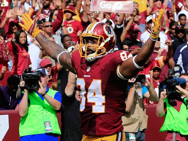 Tight end Niles Paul #84 of the Washington Redskins celebrates after catching a fourth quarter touchdown against the Jacksonville Jaguars at FedExField on September 14, 2014