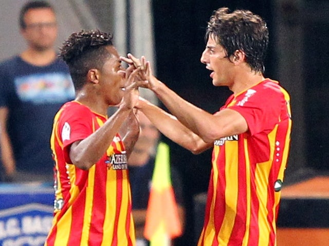 Lens' Argentine forward Pablo Chavarria (R) is congratulated by a teammate during the French L1 football match Bastia (SCB) against Lens (RCL) on September 13, 2014