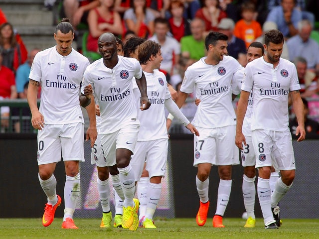 Paris' French defender Zoumana Camara celebrates with his teammates after scoring during the French L1 football match between Rennes (SRFC) and Paris Saint-Germain (PSG) on September 13, 2014