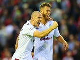 Philippe Senderos (L) of Aston Villa celebrates victory with Nathan Baker after the Barclays Premier League match against Liverpool on September 13, 2014
