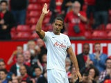 Rio Ferdinand of QPR salutes the crowd at the end of the Barclays Premier League match between Manchester United and Queens Park Rangers at Old Trafford on September 14, 2014