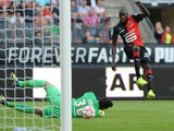 Rennes' French midfielder Abdoulaye Doucoure scores in front of Paris' Italian goalkeeper Salvatore Sirigu during the French L1 football match between Stade Rennais FC and Paris Saint-Germain (PSG), on September 13, 2014