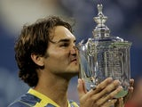 Roger Federer of Switzerland kisses the championship trophy after defeating Andre Agassi in the men's final of the US Open at the USTA National Tennis Center in Flushing Meadows Corona Park on September 11, 2005