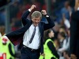 England manager Roy Hodgson celebrates during the Euro 2016 qualifying group match against Switzerland in Basel on September 8, 2014