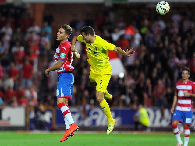 Granada's forward Ruben Rochina (L) vies with Villarreal's defender Mario Gaspar Perez Martinez during the Spanish league football match on September 14, 2014