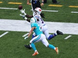 Sammy Watkins #14 of the Buffalo Bills attempts a catch as Brent Grimes #21 of the Miami Dolphins defends during the first half at Ralph Wilson Stadium on September 14, 2014