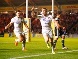 Chris Ashton of Saracens celebrates scoring their second try during the Aviva Premiership match between Harlequins and Saracens at Twickenham Stoop on September 12, 2014