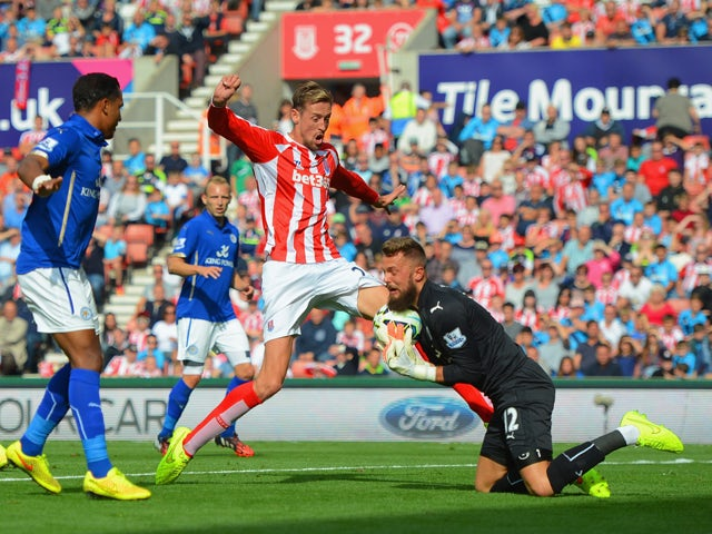 Ben Hamer of Leicester City makes a save from Peter Crouch of Stoke City during the Barclays Premier League match between Stoke City and Leicester City at Britannia Stadium on September 13, 2014