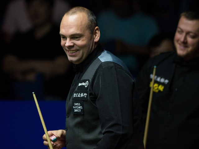 Britain's Stuart Bingham reacts during the final of the Snooker Shanghai Masters against Mark Allen of Northern Ireland in Shanghai on September 14, 2014