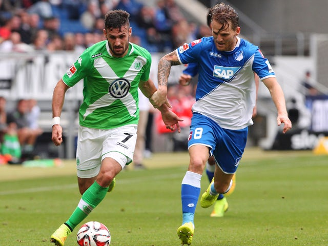 Wolfsburg's midfielder Daniel Caligiuri and Hoffenheim's midfielder Eugen Polanski vie for the ball during the German first division Bundesliga football match 1899 Hoffenheim vs VfLWolfsburg in Sinsheim, southwestern Germany on September 13, 2014