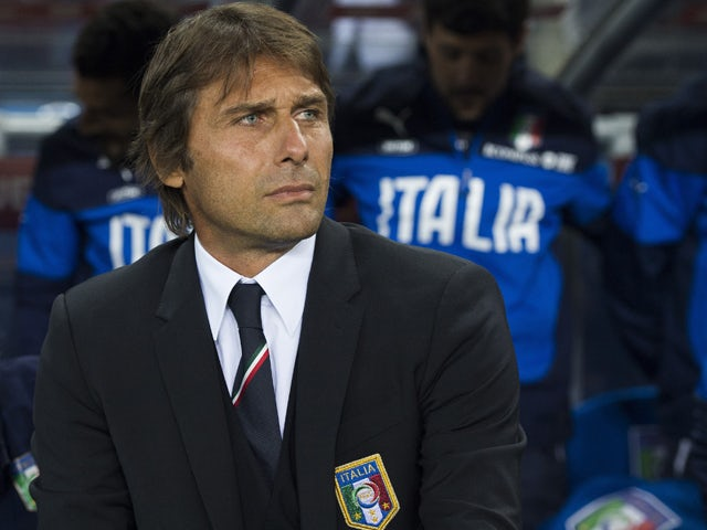 Italy's coach Antonio Conte follows the action during the UEFA Euro 2016 Group H qualifying football match Norway vs Italy on September 9, 2014