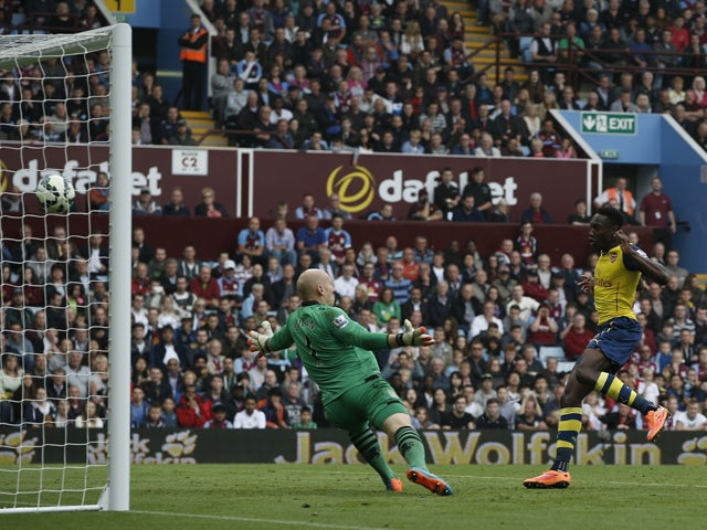 Arsenal's English striker Danny Welbeck shoots to score their second goal during the English Premier League football match between Aston Villa and Arsenal at Villa Park in Birmingham, central England on September 20, 2014