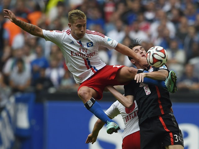 Hamburg's midfielder Lewis Holtby and Bayern Munich's Danish midfielder Pierre Hojbjerg vie for the ball during the German first division Bundesliga football match Hamburger SV vs FC Bayern Munich at the Imtech Arena in Hamburg, northern Germany on Septem