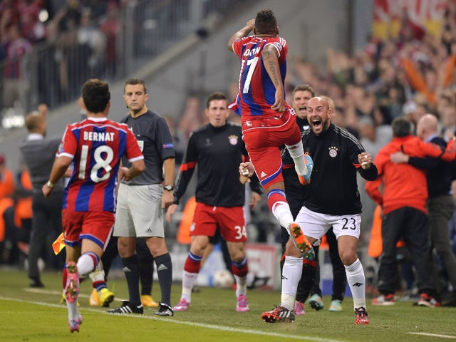 Bayern Munich's German defender Jerome Boateng celebrates his goal during the first leg UEFA Champions League Group E football match Borussia FC Bayern Munchen v Manchester City in Munich, Germany on September 17, 2014