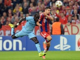 Bayern Munich's Polish striker Robert Lewandowski and Manchester City's French defender Bacary Sagna challenge for the ball during the first leg UEFA Champions League Group E football match Borussia FC Bayern Munchen v Manchester City in Munich, Germany o