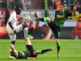 Koln's Nigerian striker Anthony Ujah, Monchengladbach's defender Tony Jantschke and Monchengladbach's Swiss midfielder Granit Xhaka vie for the ball during the German first division Bundesliga football match 1 FC Koln vs Borussia Monchengladbach in Cologn