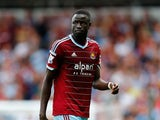 Cheikhou Kouyate of West Ham looks on during the Premier League match between West Ham United and Tottenham Hotspur at Boleyn Ground on August 16, 2014