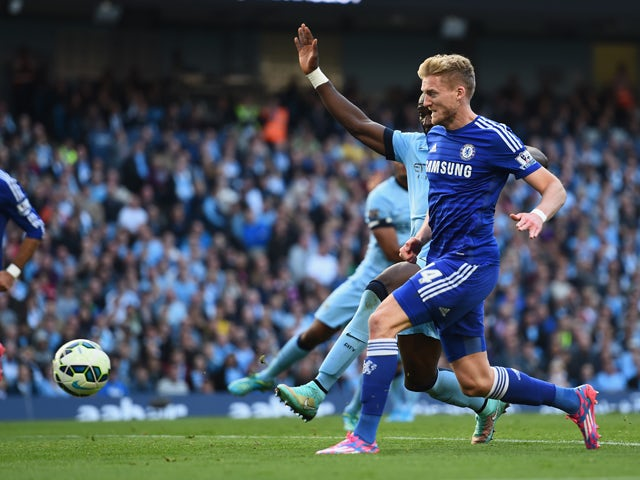 Andre Schurrle of Chelsea scores the first goal during the Barclays Premier League match between Manchester City and Chelsea at the Etihad Stadium on September 21, 2014