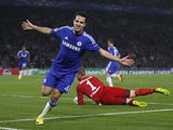 Chelseas Spanish midfielder Cesc Fabregas celebrates scoring the opening goal of the UEFA Champions League, group G football match between Chelsea and Schalke 04 at Stamford Bridge, in London on September 17, 2014