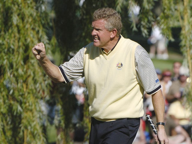 Colin Montgomerie drops a birdie putt on the 16th hole during Sunday afternoon singles matches at the 2004 Ryder Cup in Detroit, Michigan, September 19, 2004