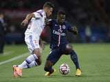 Lyon's French midfielder Corentin Tolisso (L) vies with Paris Saint-Germain's French defender Serge Aurier during the French L1 football match on September 21, 2014