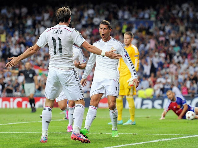 Cristiano Ronaldo of Real Madrid celebrates with Gareth Bale after scoring Real's 3rd goal during the UEFA Champions League Group B match  against Basel on September 16, 2014