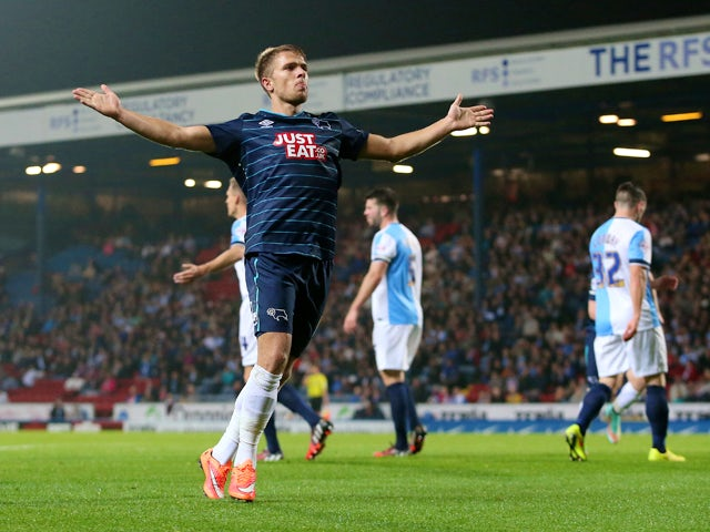 Jamie Ward of Derby County celebrates his goal infront of the travelling fans during the Sky Bet Championship match between Blackburn Rovers and Derby County at Ewood Park on September 17, 2014