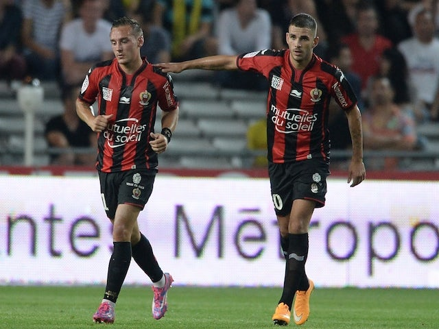 Nice's French midfielder Eric Bautheac (L) and Nice's French midfielder Valentin Eysseric reacts after Bautheac scored a goal during the French L1 football match against Nantes on September 20, 2014