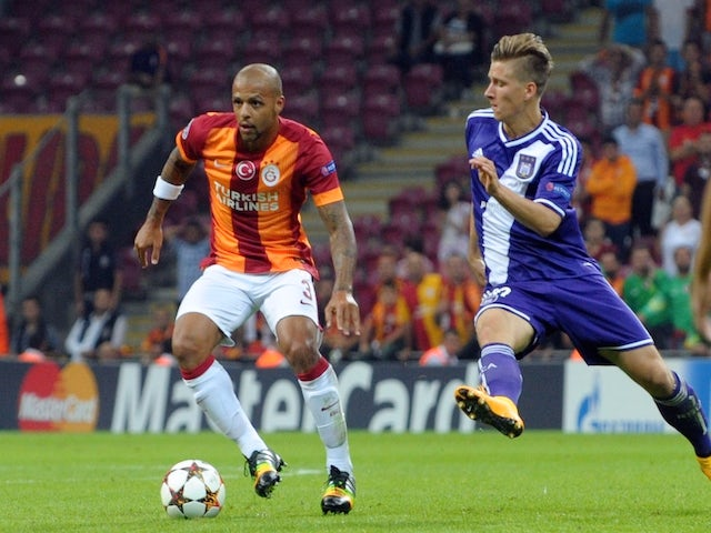 Galatasaray's Brazilian midfielder Felipe Melo (L) vies for the ball with Anderlecht's Dennis Praet during the UEFA Champions League group D match on September 16, 2014