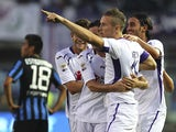 Jasmin Kurtic of ACF Fiorentina celebrates with his team-mates after scoring the opening goal during the Serie A match between Atalanta BC and ACF Fiorentina at Stadio Atleti Azzurri d'Italia on September 21, 2014