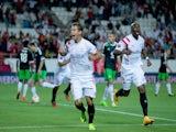 Grzegorz Krychowiak (L) of Sevilla FC celebrates scoring their opening goal with teammate Stephane Mbia Etoundi (R) during the UEFA Europa League group G match against Feyenoord on September 18, 2014