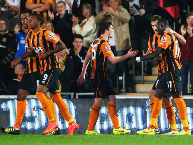 Mohamed Diame of Hull City celebrates with Andrew Robertson and Nikica Jelevic as he scores their second goal during Barclays Premier League match between Hull City and West Ham United at KC Stadium on September 15, 2014