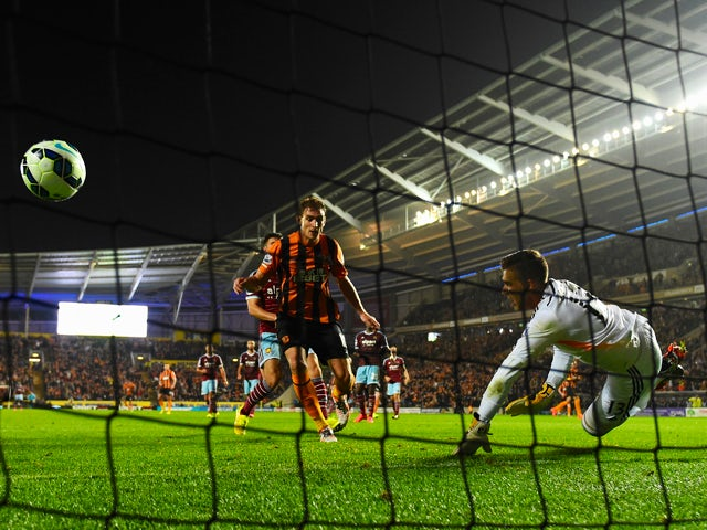 Hull striker Nikica Jelavic scores past West Ham goalkeeper Adrian but the 'goal' is chalked off during the Barclays Premier League match between Hull City and West Ham United at KC Stadium on September 15, 2014