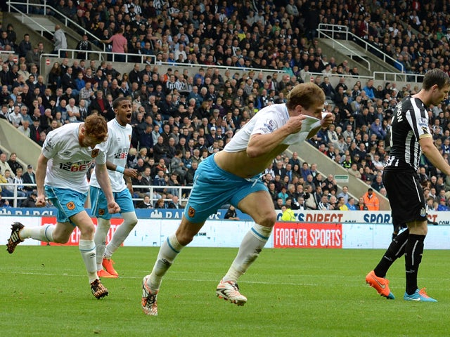 Nikica Jelavic of Hull City celebrates scoring during Premier League Football match between Newcastle United and Hull City at St James' Park on September 20, 2014