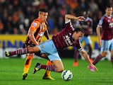 Hull player Jake Livermore challenges Mark Noble of West Ham during the Barclays Premier League match between Hull City and West Ham United at KC Stadium on September 15, 2014