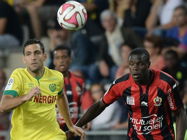 Nantes' Israeli forward Itay Shechter (L) vies with Nice's French and Haitian defender Romain Genevois during the French L1 football match between Nantes (FCN) and Nice (OGCN) on September 20, 2014